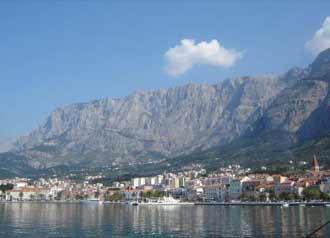 A view of Baška Voda underneath the Biokovo mountain